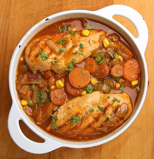 Slow-cooked chicken casserole with onions, carrots and celery an